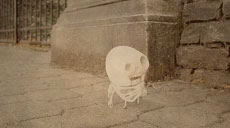 small skeleton puppet on the street